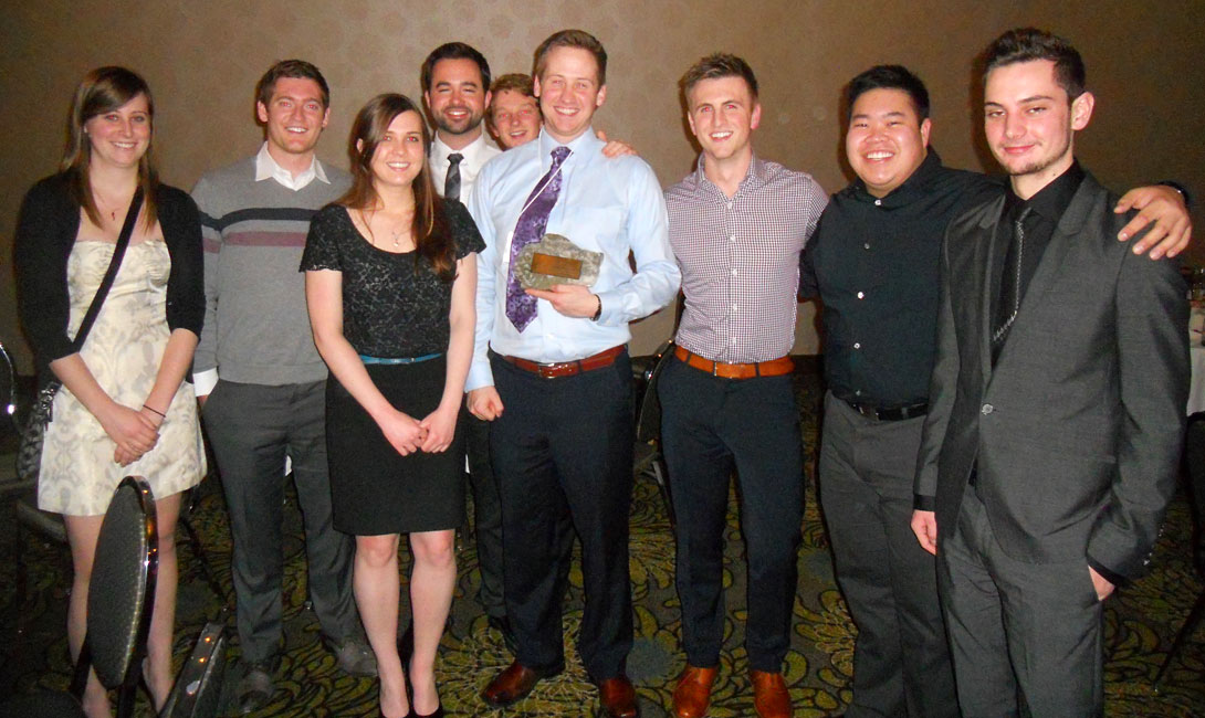 U of C GUSS students receive the mantle for the WIUGC 2014 in Calgary.